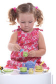 Little girl playing at tea party — Stock Photo