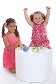 Little girls playing at tea parties — Stock Photo