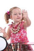 Girl putting on jewellery — Stockfoto