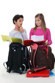 Schoolchildren comparing homework — Foto Stock