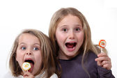 Little girls with lollipops — Stock Photo