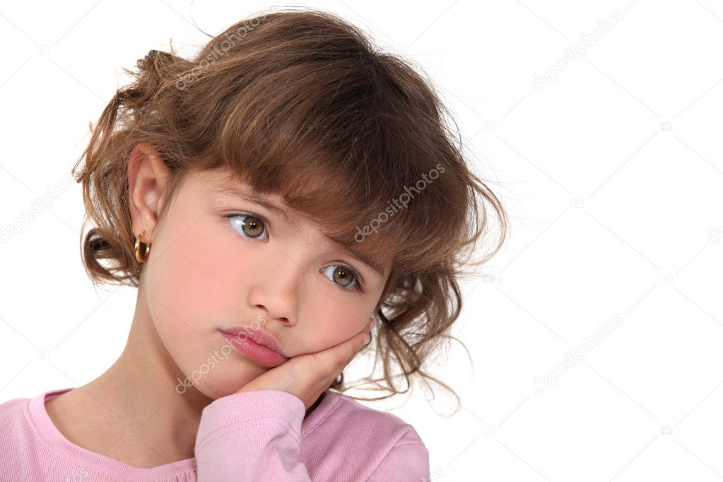 Little girl with expression of sadness  Stock Photo #10474634