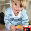 Little boy playing with toys — Stock Photo