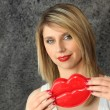 Stock Photo: Blond womholding comedy plastic lips