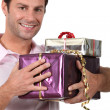 Man holding gifts — Stock Photo #10492425