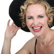 Womwith hat laughing — Stock Photo #10492533