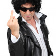 Man dressed as rebel biker - Stock Photo