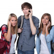 Stock Photo: Teenagers with backpacks and mobile
