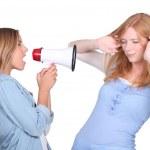Girl shouting through a megaphone — Stock Photo