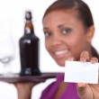 Waitress carrying tray and holding business card — Stock Photo #10493275