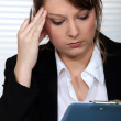 Stock Photo: A businesswoman having a headache.