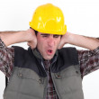 A construction worker covering his ears. — Stock Photo #10494576