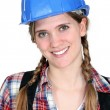 Stock Photo: Portrait of smiling tradeswoman