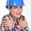 Stock Photo: Scared female builder
