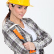 Stern looking female builder with hammer — Stock Photo #10495900