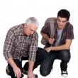 Tiler and apprentice — Stock Photo