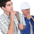 Manual worker and his trainee thinking. — Stock Photo #10496134
