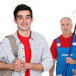 Decorator and his apprentice — Stockfoto