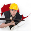 Workman with a pickaxe — Stock Photo #10496509