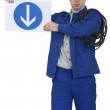Stock Photo: Menacing traffic guard holding sign
