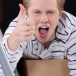 Thumbs up from a man with cardboard boxes - Stock Photo