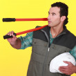 Man resting bolt-cutters on his shoulder — Stock Photo