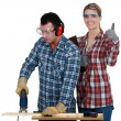 Woman inspecting carpenter — Stock Photo
