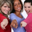 Stock Photo: Group of young women pointing their fingers