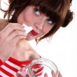 Woman eating candy - Stock Photo
