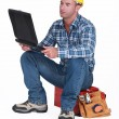 Stockfoto: Tradesmchecking his emails