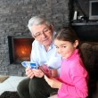 Stock Photo: Grandfather and granddaughter playing cards