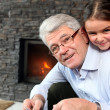 Stock Photo: Grandfather and granddaughter playing
