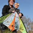 Father and son with a kite — Stock Photo