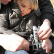 Father and using using microscope in a field — Stock Photo