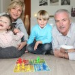 Family playing board game — Stock Photo #10499527