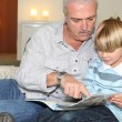 Grandfather reading a story — Stock Photo