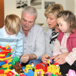 Grandparents and grandchildren playing — Stock Photo