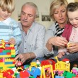 Grandparents and grandchildren playing together — Stock Photo