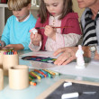 Grandma painting with grandchildren — Stock Photo