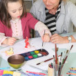 Stock Photo: Mother and daughter painting