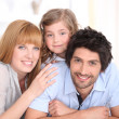 Parents and young daughter on bed together — Stock Photo #10499907