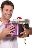 Man holding gifts — Stock Photo