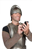 Knight of the Middle Ages with telephone — Stock Photo