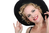 Theatrical woman in a black hat and red lipstick — Stock Photo