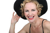 Woman with a hat laughing — Stock Photo