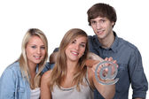 Three friends holding at symbol — Stock Photo