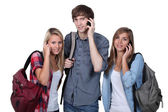 Teenagers with backpacks and mobile — Stok fotoğraf