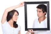 Boy and girl with black frame — Stock Photo