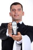 Waiter showing phone — Stock Photo