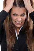 Businesswoman pulling hair out — Stock Photo